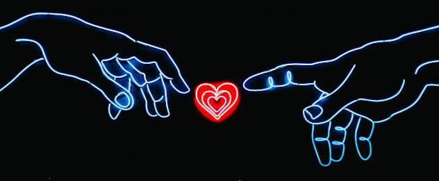Obrazek ilustrujący dwie dłonie wyciągnięte ku ikonie serca, która znajduje się po środku obrazka.